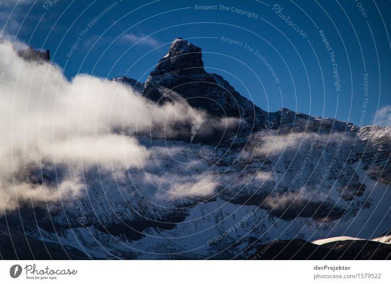 Schneebedeckter Berg in Savoien II Zentralperspektive Starke Tiefenschärfe Sonnenstrahlen Sonnenlicht Lichterscheinung Silhouette Kontrast Schatten Tag