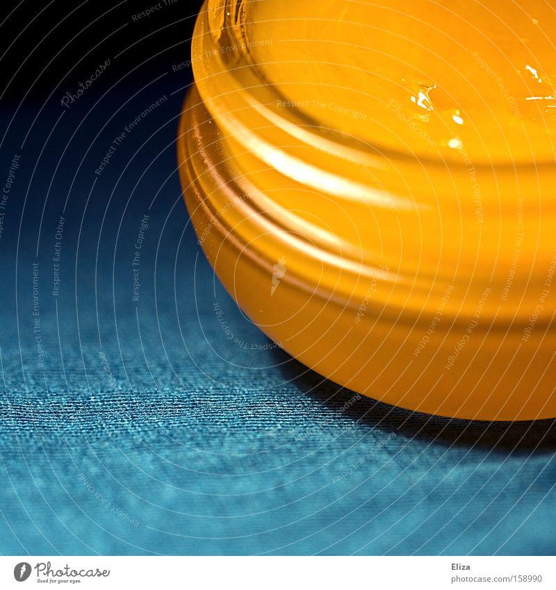 Goldcreme schön gelb glänzend Gold gold ästhetisch türkis Dose Verpackung Drehgewinde Plastikdose