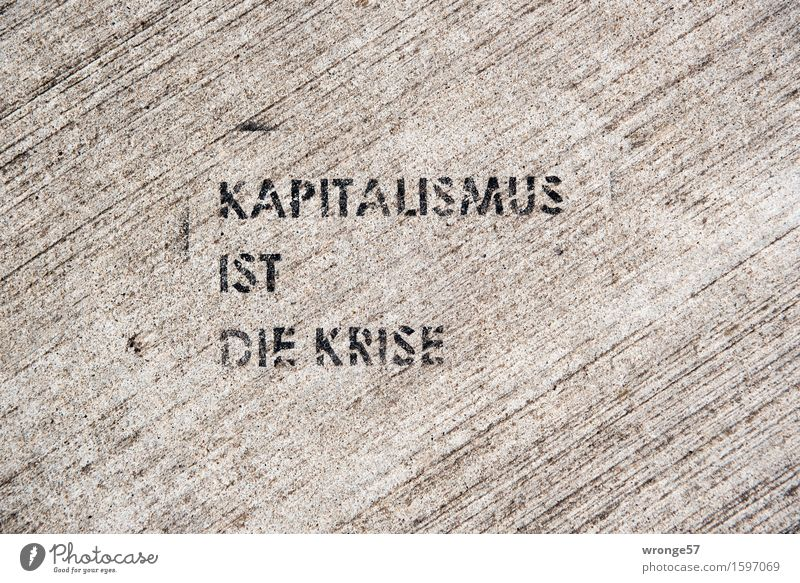 These Graffiti Neue Medien Schriftzeichen Kommunizieren rebellisch Stadt grau schwarz Straße Straßenbelag Beton Betonplatte Straßenkunst Kapitalismus Krise