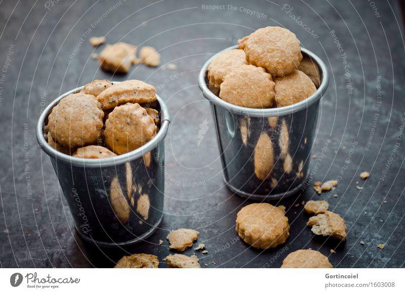 Käsecracker Lebensmittel Teigwaren Backwaren Ernährung Vegetarische Ernährung Slowfood Fingerfood lecker Snack Käsegebäck Keks Essen Knabbereien Mohn Farbfoto
