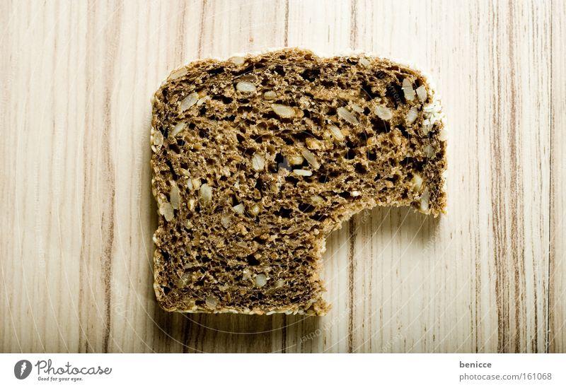angebissen Brot Vollkorn beißen Ernährung Backwaren Broscheibe Fensterscheibe Zähne Körnerbrot
