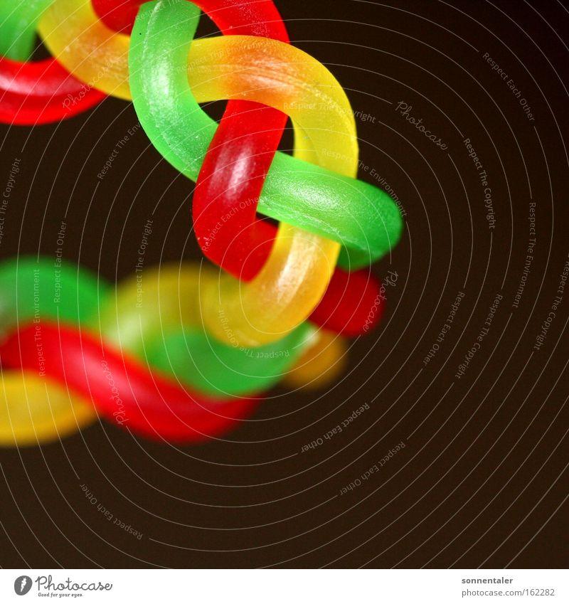 süßwarenkette Süßwaren Schnur mehrfarbig rot grün gelb Kette geflochten Zopf Verbindung Farbe durcheinander Schlaufe wickeln Makroaufnahme Nahaufnahme binden