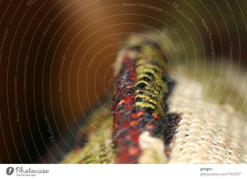 Wulst alt grün rot weich Stoff Tiefenschärfe Textilien beige Kissen Naht Faser gewebt