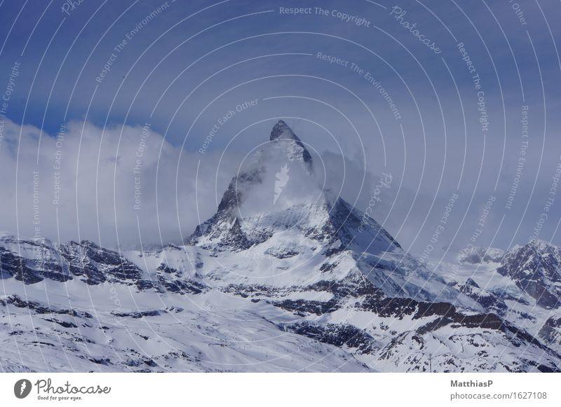 Matterhorn | Zermatt in der Schweiz Himmel Natur blau weiß Landschaft Einsamkeit Wolken Ferne Winter Berge u. Gebirge Schnee außergewöhnlich Tourismus träumen Kraft Lebensfreude