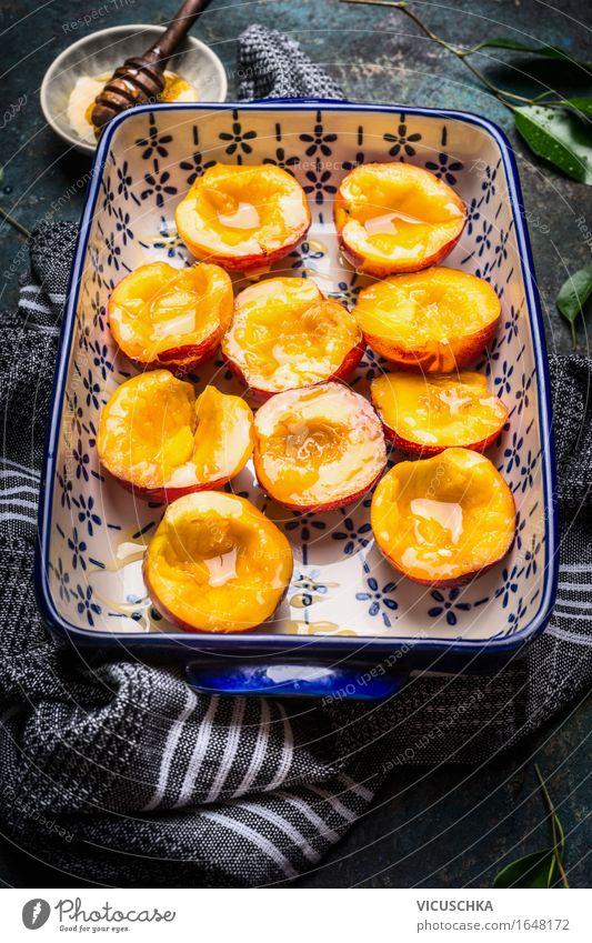 Auflaufform mit Pfirsichen und Honig Lebensmittel Frucht Dessert Süßwaren Ernährung Frühstück Bioprodukte Vegetarische Ernährung Schalen & Schüsseln Stil Design