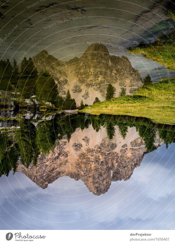 Spiegelung eines Berges in den Dolomiten IV Zentralperspektive Starke Tiefenschärfe Sonnenstrahlen Sonnenlicht Lichterscheinung Silhouette Kontrast Schatten Tag