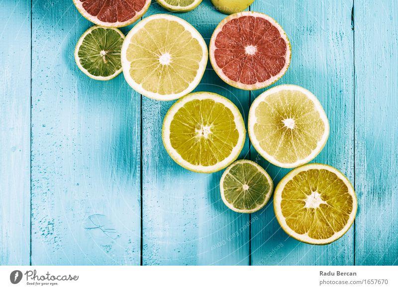 Kalk, Zitronen, Orangen und Grapefruit Früchte auf Türkis Tisch blau grün Farbe Gesunde Ernährung rot gelb Essen Gesundheit Lebensmittel Frucht orange