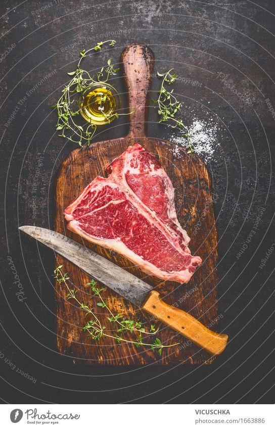 T-Bone- Steak auf alter Schneidebrett mit Messer Lebensmittel Fleisch Kräuter & Gewürze Öl Ernährung Mittagessen Abendessen Picknick Bioprodukte Stil