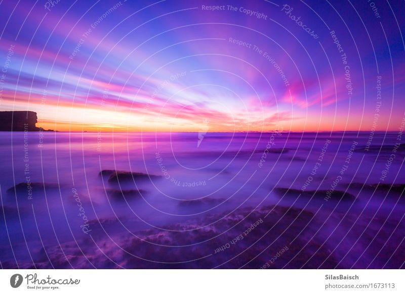 Ein bunter Sonnenaufgang Himmel Natur Ferien & Urlaub & Reisen Landschaft Wolken Freude Strand Umwelt Küste Lifestyle Freiheit Felsen Horizont Tourismus Wellen