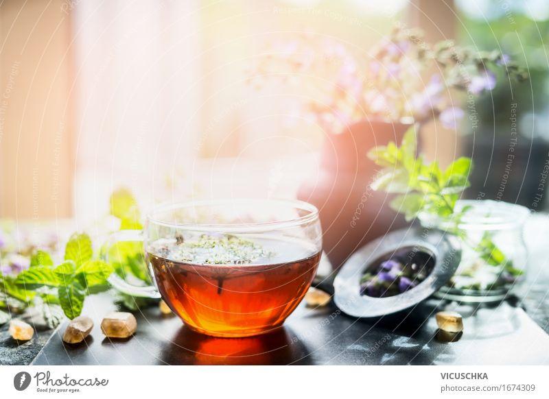 Tasse mit Kräutertee auf Fensterbrett Lebensmittel Kräuter & Gewürze Ernährung Bioprodukte Getränk Heißgetränk Tee Glas Löffel Lifestyle Stil Design Gesundheit