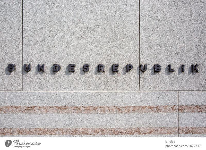 BUNDESREPUBLIK Deutschland Mauer Wand Stein Metall Zeichen Schriftzeichen Linie ästhetisch einfach grau schwarz Macht Pünktlichkeit gewissenhaft