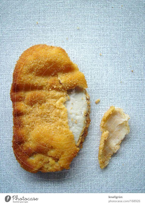 Das Schnitzel sieht bekloppt aus weiß grau braun Lebensmittel kaputt genießen Fleisch satt gebraten