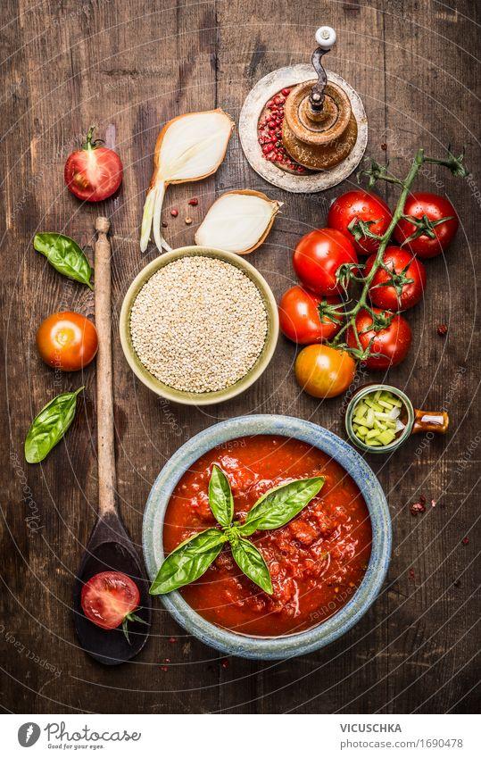 Quinoa mit Tomaten Sauce und frischen Zutaten Lebensmittel Gemüse Getreide Kräuter & Gewürze Ernährung Mittagessen Büffet Brunch Bioprodukte