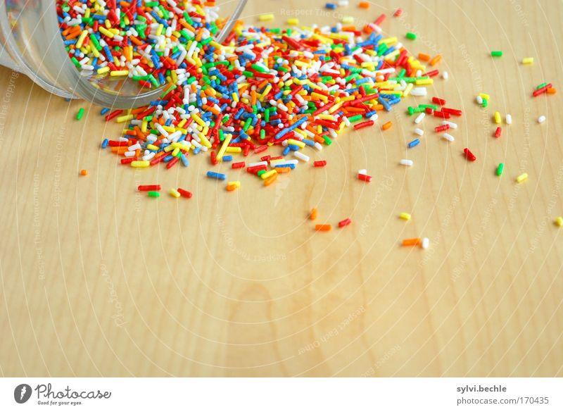 Unordnung Lebensmittel Süßwaren Ernährung Schalen & Schüsseln Dose lecker süß fantastisch Streusel Holz Tisch Maserung Krümel Glas ausleeren chaotisch ungesund