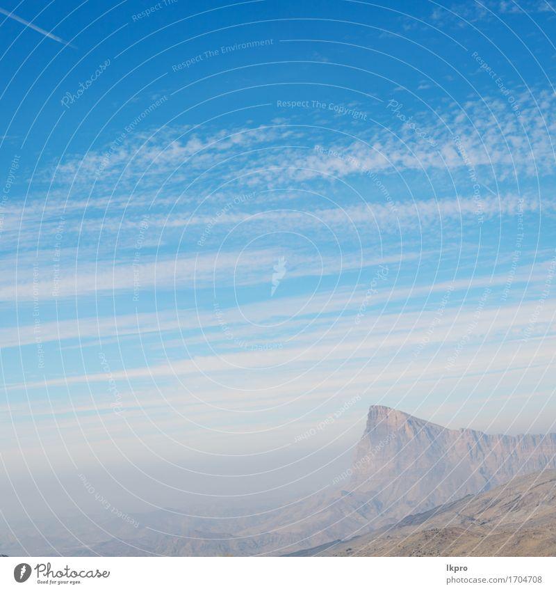 bewölkter Himmel in Oman der alte Berg Natur Ferien & Urlaub & Reisen Pflanze weiß Baum Landschaft Wolken schwarz Berge u. Gebirge Straße grau Stein Felsen