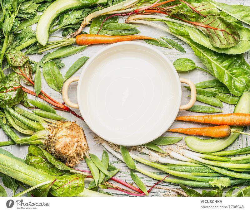 Grünes Gemüse um leerem Kochtopf Lebensmittel Ernährung Mittagessen Abendessen Bioprodukte Vegetarische Ernährung Diät Slowfood Topf Stil Design