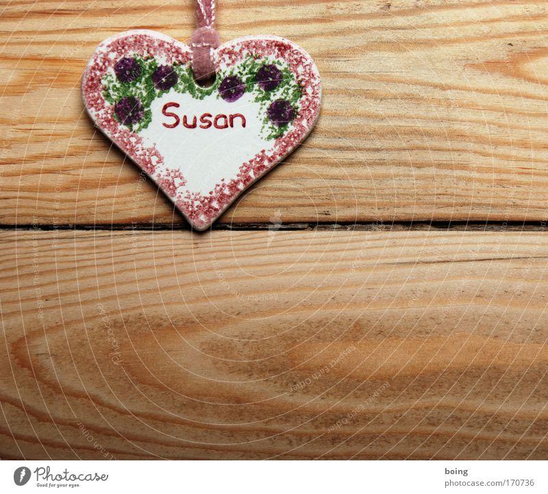 Die Susan Studioaufnahme Wohnung Accessoire Schmuck Zeichen Schriftzeichen Herz Häusliches Leben Glück Namensschild Vorname weiblicher Vorname Schmuckanhänger