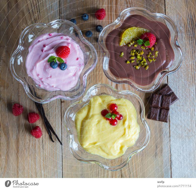 Dessert Variation Schokoladencreme Himbeercreme Vanillecreme Holz süß Schokopudding Himbeerpudding Vanillepudding Pudding Schokoladen pudding Nussnugatcreme