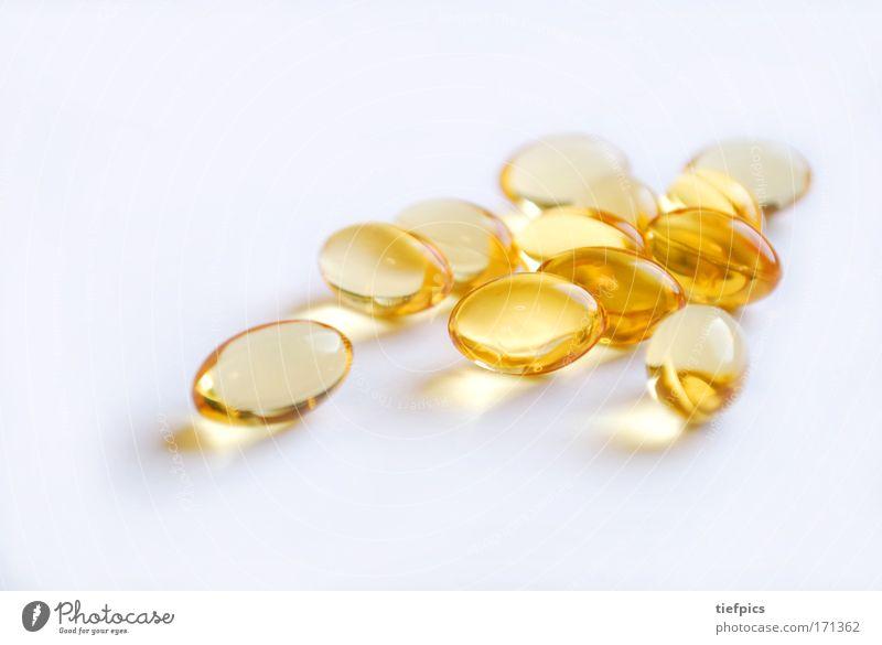 goldene kapseln Nahaufnahme Hintergrund neutral Schwache Tiefenschärfe Gesundheit Gesundheitswesen Wissenschaften Kapsel Tablette medikamentensucht