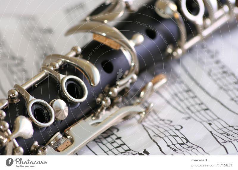 Klarinette clarinet Detailaufnahme black wooden Nahaufnahme notes sheet Musik Musikinstrument blowing ebonit Musiknoten Klappe Holzblasinstrumente