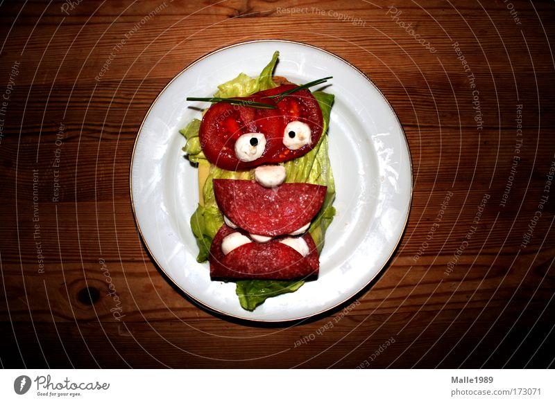 Tellermonster Fleisch Gesicht Ernährung Lebensmittel lustig verrückt mehrfarbig Tisch wild Küche Backwaren Porträt beobachten Getreide gruselig