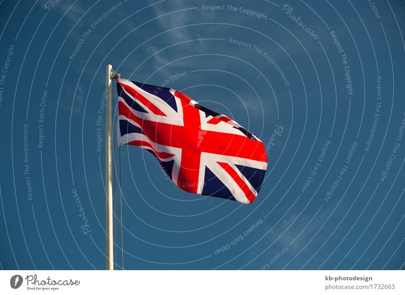 Great Britain flag in front of a blue sky Ferien & Urlaub & Reisen Business Wind Zeichen Fahne Großbritannien United Kingdom British English Island isle Europa