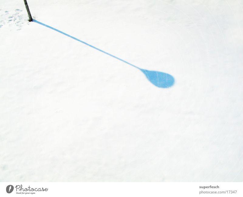 Laternenschatten Winter Schnee verrückt