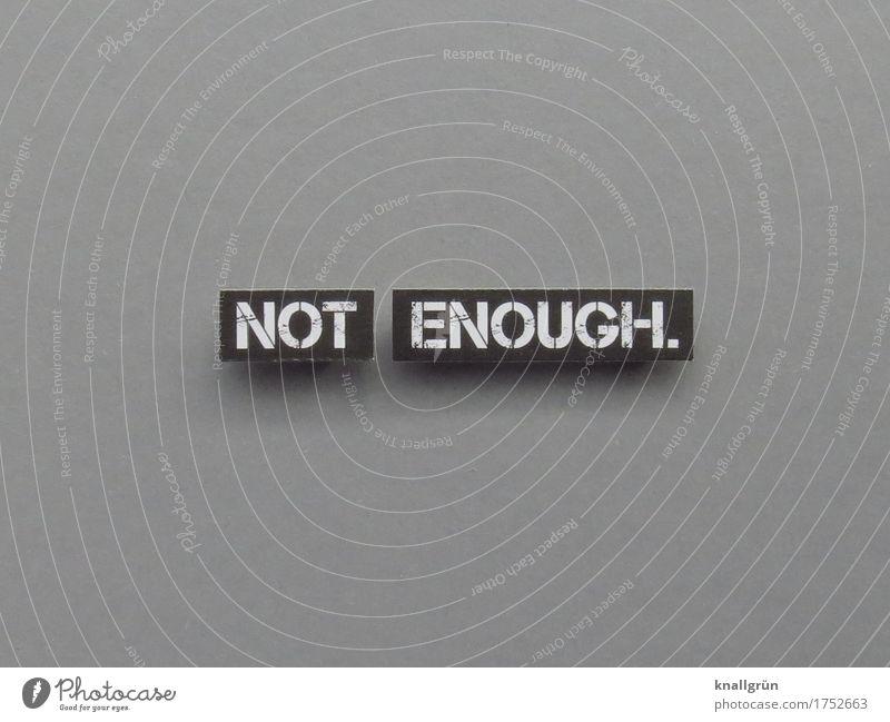 NOT ENOUGH. Schriftzeichen Schilder & Markierungen Kommunizieren eckig Gefühle Gier Erwartung Frustration Farbfoto Gedeckte Farben Studioaufnahme Menschenleer