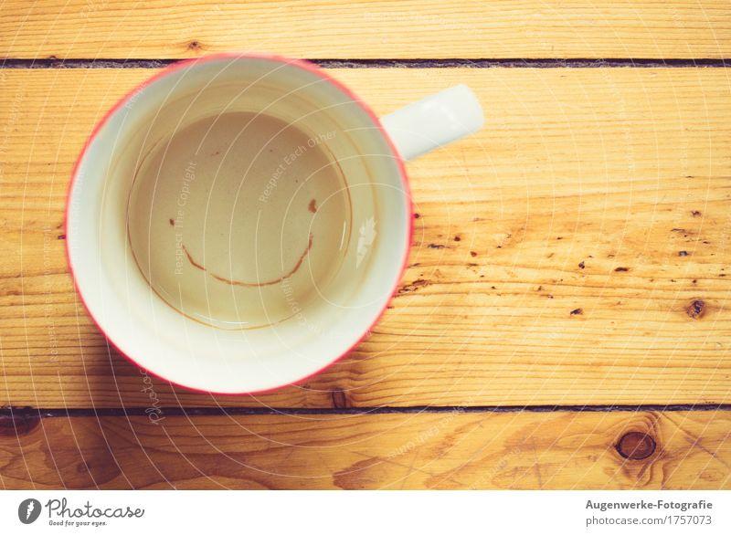 Tasse Holz Fröhlichkeit lustig positiv Wärme braun gelb Freude Glück Lebensfreude Lächeln grinsen Gute Laune Teetasse Farbfoto Innenaufnahme Nahaufnahme
