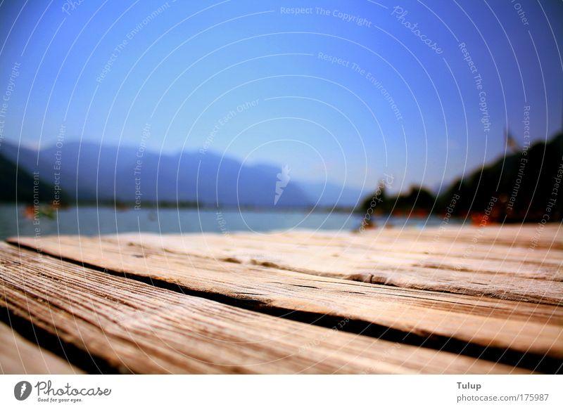 Steg am See Wasser blau Sommer Ferien & Urlaub & Reisen Erholung Glück See Wärme Zufriedenheit braun liegen Freizeit & Hobby heiß Gelassenheit Sonnenbad Seeufer
