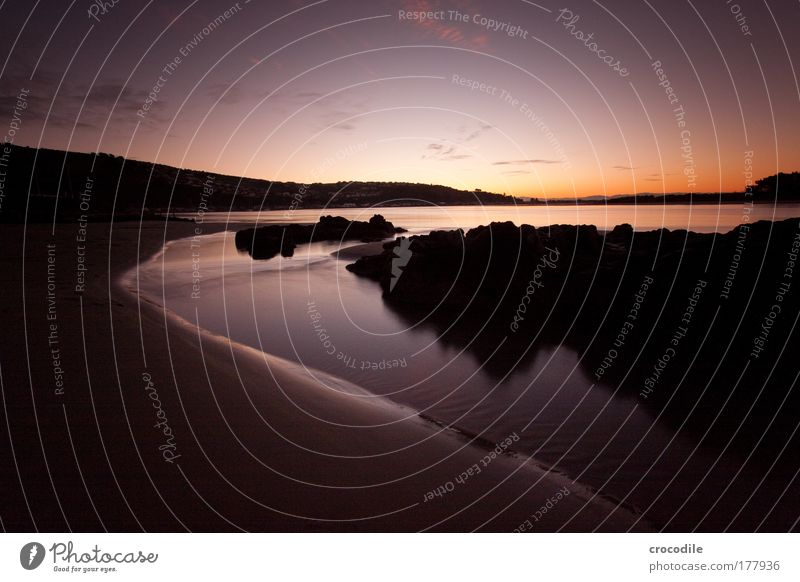 sunset over sunmer beach Natur Wasser Himmel Meer Strand Wolken Einsamkeit Sand Landschaft Zufriedenheit Küste Wetter Umwelt Felsen Erde ästhetisch