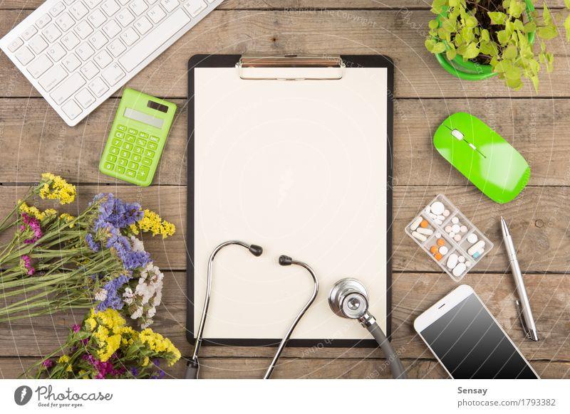 Arbeitsplatz eines Arztes Pflanze grün weiß Holz Business braun oben Arbeit & Erwerbstätigkeit Textfreiraum Büro Tisch Computer Papier Telefon Medikament