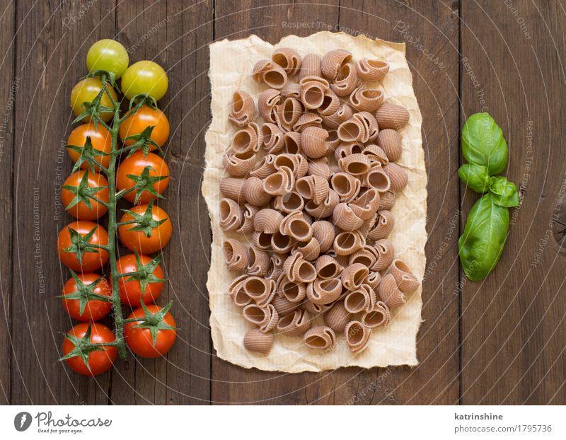 Vollkornnudeln, Tomaten und Basilikum grün rot dunkel Gesundheit braun Ernährung frisch Italien Kräuter & Gewürze Gemüse Backwaren Mahlzeit