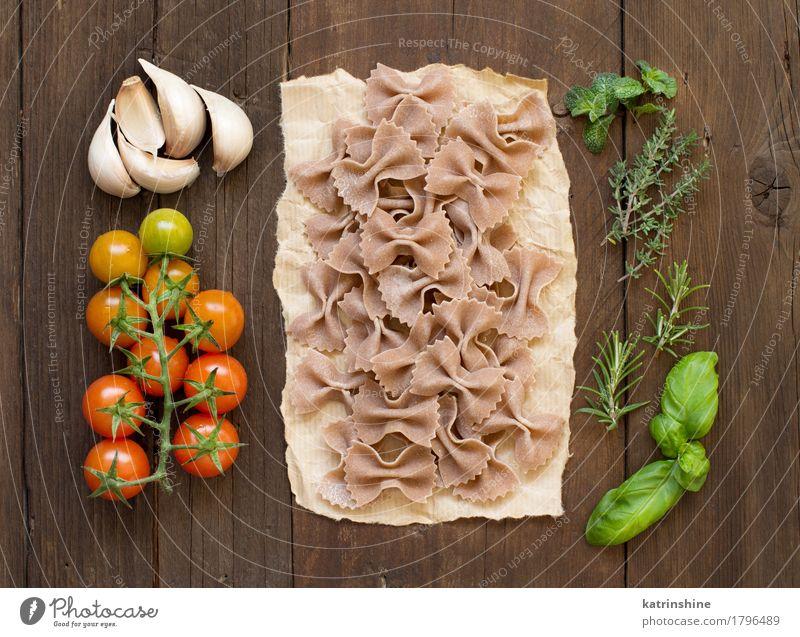 Vollkornnudeln, Gemüse und Kräuter Teigwaren Backwaren Kräuter & Gewürze Vegetarische Ernährung Diät dunkel frisch braun grün rot Tradition Basilikum