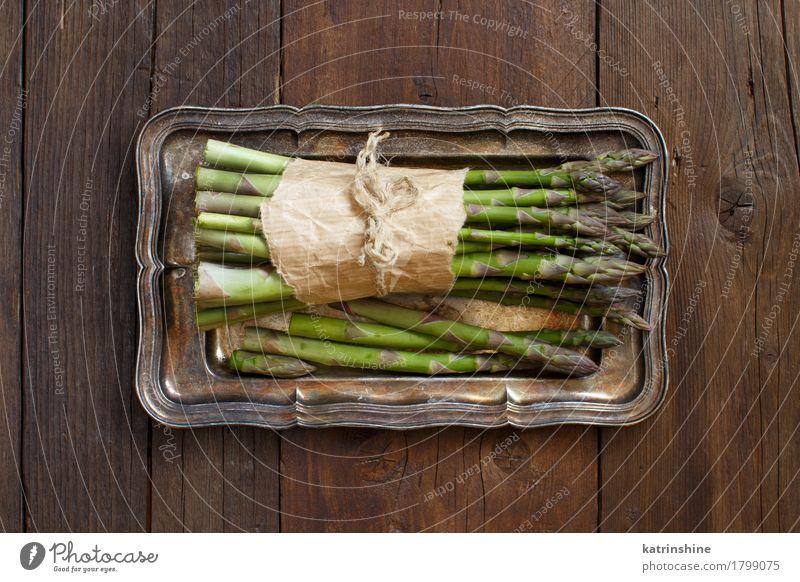 Bündel frische Spargelstangen Gemüse Ernährung Abendessen Vegetarische Ernährung Diät Tisch Metall dunkel Gesundheit natürlich braun grün Lebensmittel