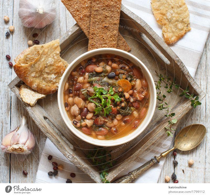Gekochte Hülsenfrüchte und Gemüse in einer Schüssel Brot Suppe Eintopf Kräuter & Gewürze Ernährung Vegetarische Ernährung Schalen & Schüsseln Löffel Holz lecker