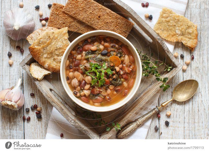 Gekochte Hülsenfrüchte und Gemüse in einer Schüssel grün weiß rot Speise natürlich Holz Lebensmittel braun Ernährung Kräuter & Gewürze kochen & garen lecker