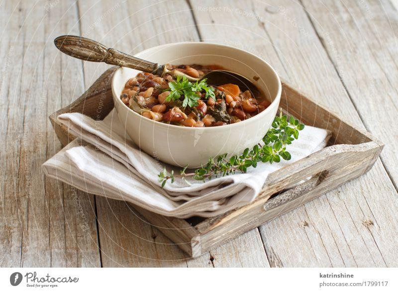 Gekochte Hülsenfrüchte und Gemüse in einer Schüssel Suppe Eintopf Kräuter & Gewürze Ernährung Vegetarische Ernährung Diät Schalen & Schüsseln Löffel Gesundheit