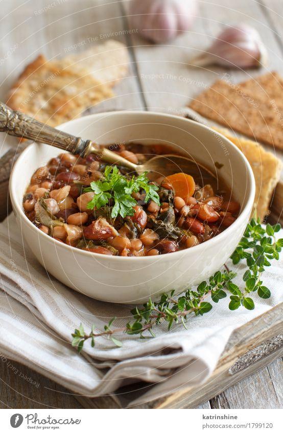 Gekochte Hülsenfrüchte und Gemüse in einer Schüssel Brot Suppe Eintopf Kräuter & Gewürze Ernährung Vegetarische Ernährung Schalen & Schüsseln Löffel Gesundheit
