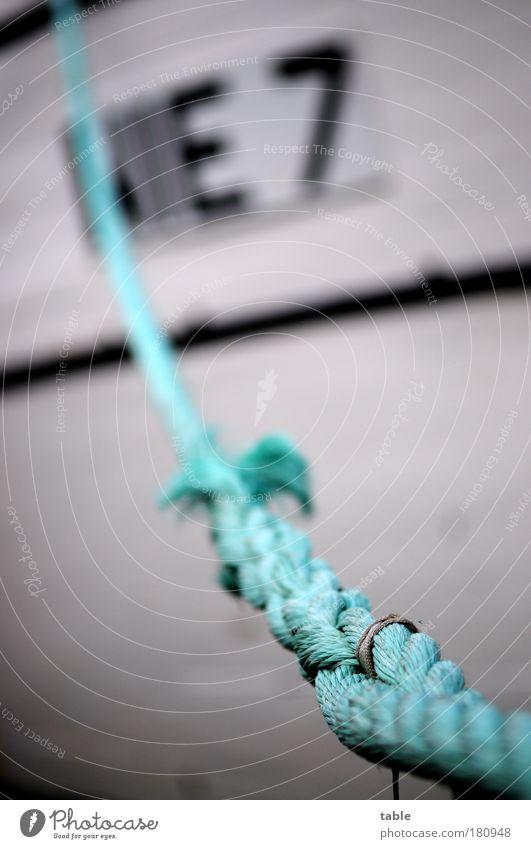 NIE 7 . . . weiß blau schwarz Gefühle Holz Wasserfahrzeug Seil Güterverkehr & Logistik authentisch Schriftzeichen Ziffern & Zahlen Hafen Neugier Kunststoff