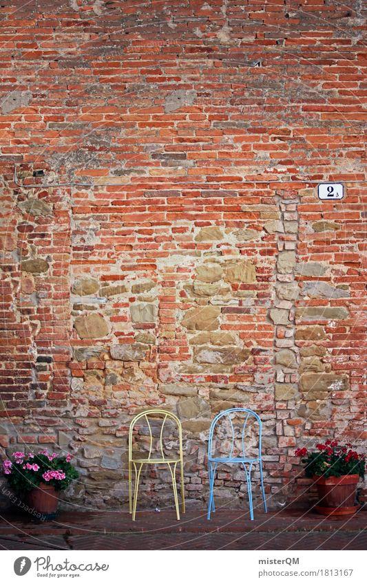 Zwei Kunst ästhetisch Stuhl Stuhllehne Stuhlreihe Stuhlgruppe mediterran 2 Backsteinwand Muster Zusammensein Blume Italien Urlaubsfoto leer Sitz sitzen