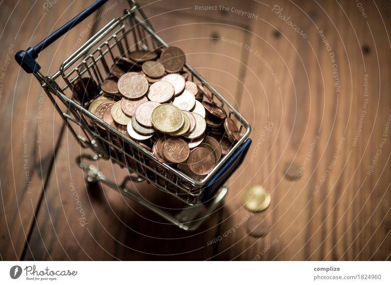 €-Münzen Lebensmittel Handel geizig kaufen Einkaufswagen sparen Cent Euro Geld Kapitalwirtschaft Angebot Ladengeschäft Supermarkt voll laden Geldmünzen Farbfoto