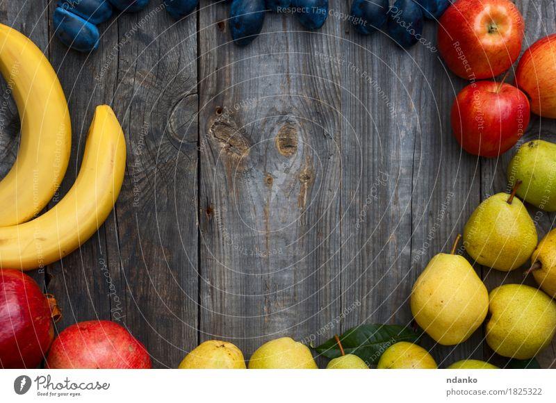 Banane, Apfel, Birne, Pflaume und Granatapfel Herbst Lebensmittel grau Frucht frisch Aussicht Top Vegetarische Ernährung horizontal saftig roh Produkt