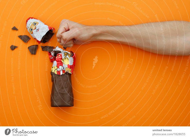 AKDR# Weihnachtsmuffel trifft Weihnachtsmann Weihnachten & Advent Kunst orange ästhetisch Arme Gewalt Schokolade Kunstwerk Faust Konsum gewaltig überschüssig