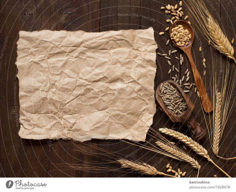 Weizen und Dinkel Hintergrund Getreide Löffel Sommer Natur Pflanze Papier Holz Wachstum frisch natürlich braun gelb Ackerbau Gerste Beautyfotografie Müsli