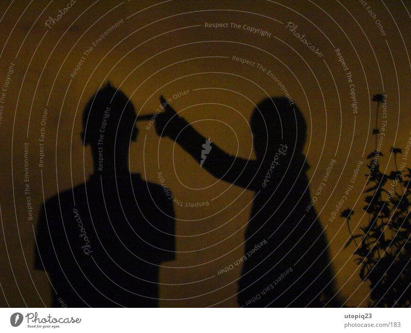 Schattenspiel Frau Mann Hand Freude Erwachsene Wand Liebe Spielen Paar Freundschaft Zusammensein Angst gefährlich Finger Coolness Schutz
