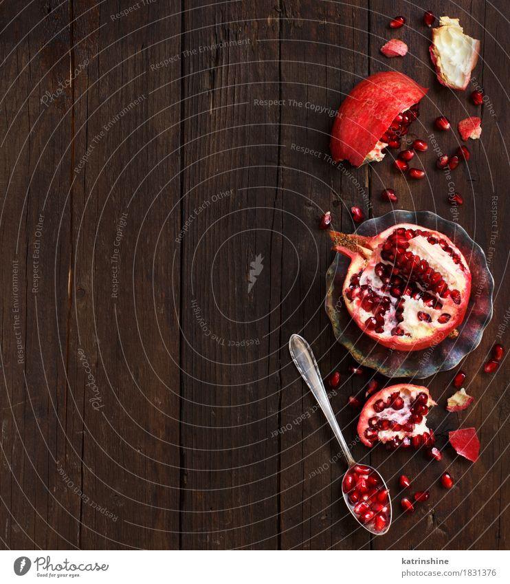 Öffnen Sie frische reife Granatäpfel Lebensmittel Frucht Ernährung Vegetarische Ernährung Diät Löffel exotisch Holz lecker saftig braun rot Ackerbau Antioxidans