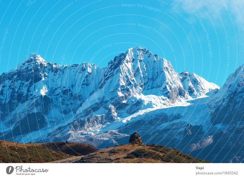 Spitze der hohen Berge, mit Schnee bedeckt Himmel Natur Ferien & Urlaub & Reisen blau weiß Landschaft Wolken Winter Berge u. Gebirge Umwelt gelb Gras Felsen
