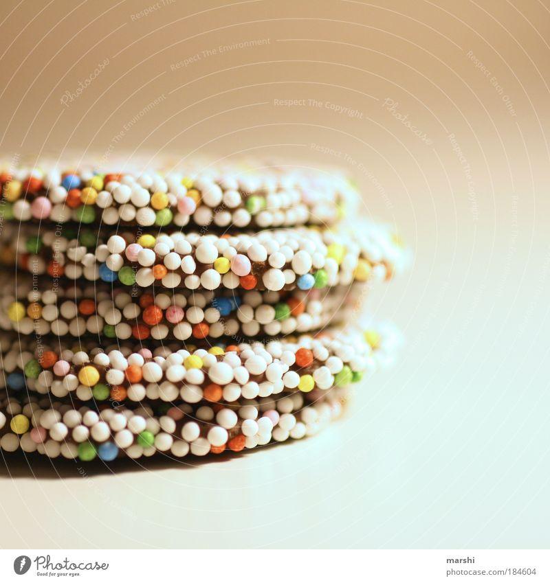 little christmas dots Farbfoto Innenaufnahme Menschenleer Süßwaren Schokolade Ernährung klein lecker süß mehrfarbig Weihnachten & Advent Punkt Unschärfe Stapel