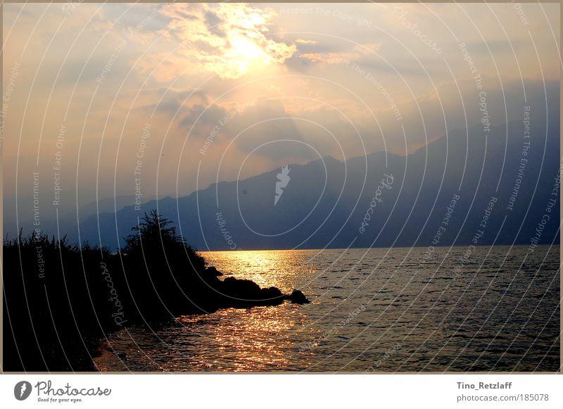 Durchbruch Natur Wasser Himmel blau Pflanze Sommer Strand Ferien & Urlaub & Reisen schwarz Wolken Erholung Berge u. Gebirge träumen Stein See Landschaft